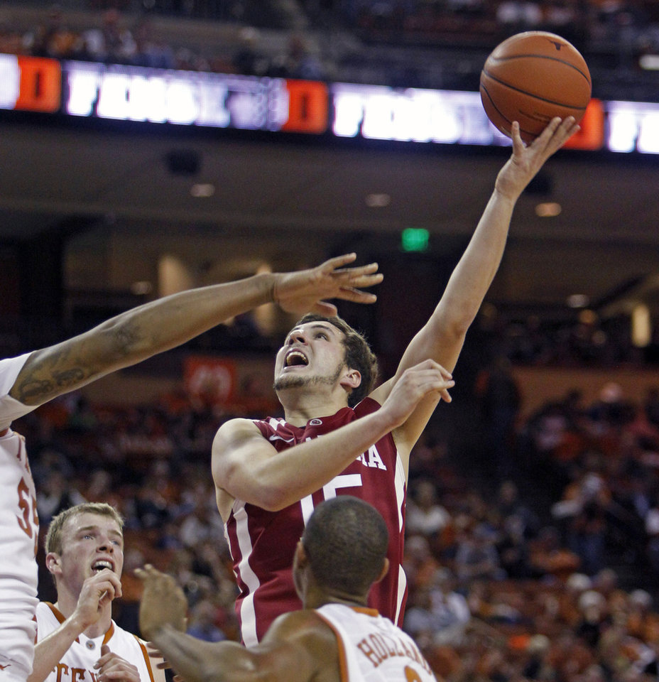 Photo - Oklahoma forward Tyler Neal (15) puts up a shot against Texas during the first half of an NCAA college basketball game, Saturday, Jan. 4, 2014, in Austin, Texas. (AP Photo/Michael Thomas)