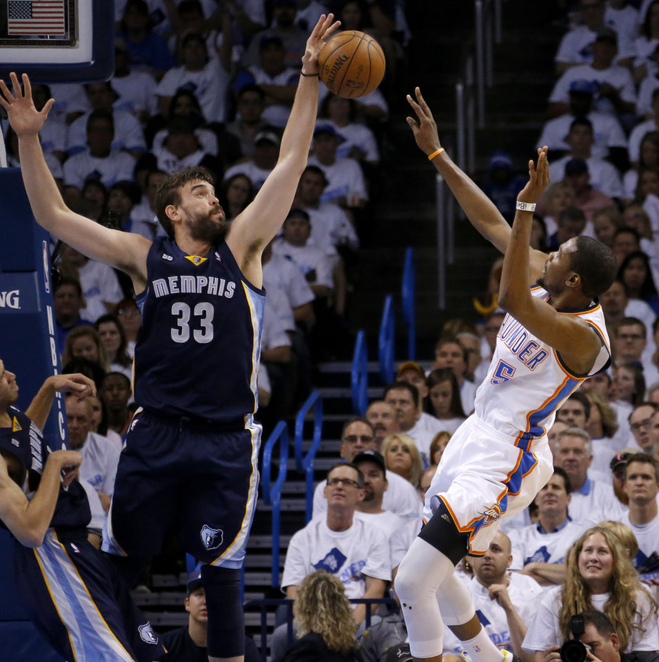 Memphis' Marc Gasol (33) blocks the shot of Oklahoma City's Kevin Durant (35) during Game 5 in the second round of the NBA playoffs between the Oklahoma City Thunder and the Memphis Grizzlies at Chesapeake Energy Arena in Oklahoma City, Wednesday, May 15, 2013.  Photo by Bryan Terry, The Oklahoman
