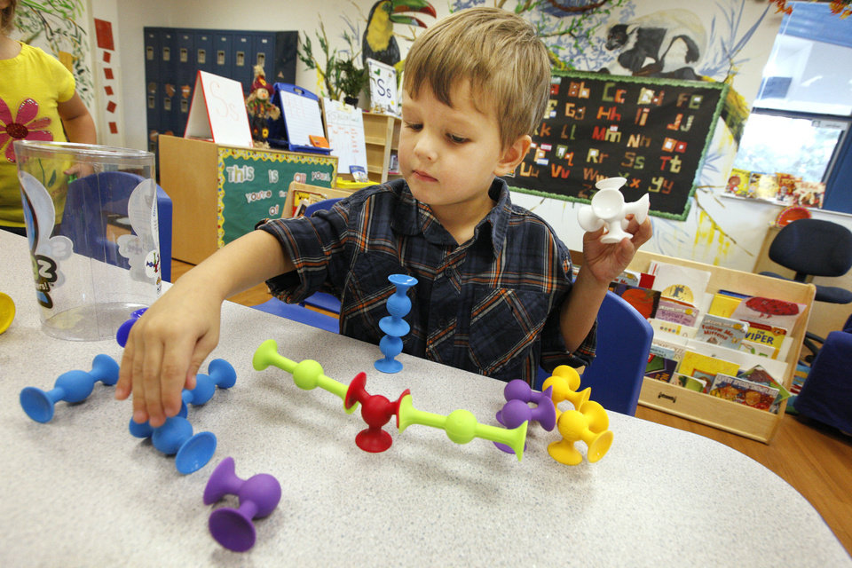 Photo - (Ed Note: school does not give out last names)  Mason, age 4,  plays with Squigz's as Pre-K students at The Goddard School on Western Ave. in Oklahoma City play with new toys during the 2013 Goddard School Preschooler Approved Toy Test Thursday, Oct. 3, 2013. Students get to try out new toys that encourage interactive play before the toys are released in stores. Photo by Paul B. Southerland, The Oklahoman
