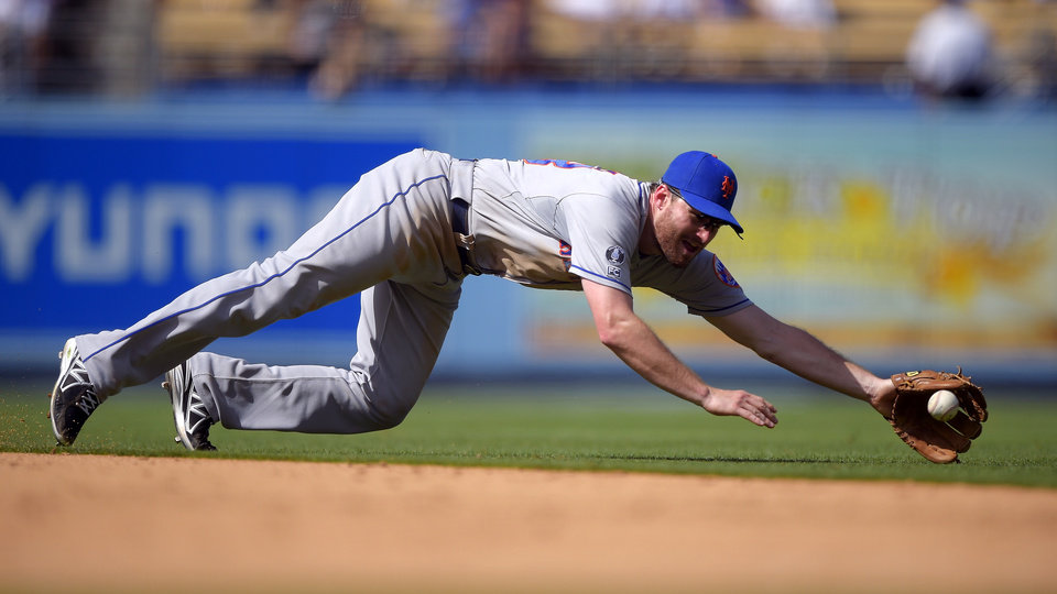 Photo - New York Mets second baseman Daniel Murphy can't reach a ball hit for a single by Los Angeles Dodgers' Andre Ethier during the seventh inning of a baseball game, Sunday, Aug. 24, 2014, in Los Angeles. (AP Photo/Mark J. Terrill)