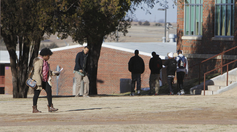 Left: Students are on the campus Thursday at Langston University. Photo By Paul Hellstern,  The Oklahoman
