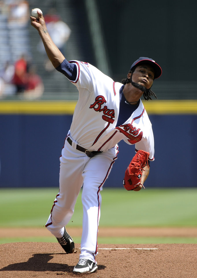 Photo - Atlanta Braves starting pitcher Ervin Santana delivers to the San Diego Padres during the first inning of a baseball game Monday, July 28, 2014, in Atlanta. (AP Photo/David Tulis)