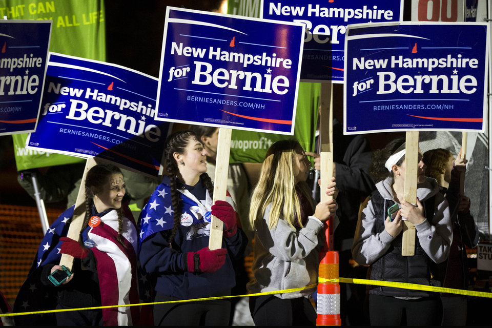 Photo - People gather ahead of a Democratic presidential debate between candidates Sen. Bernie Sanders, I-Vt, Thursday, Feb. 4, 2016, at University of New Hampshire in Durham, N.H. (AP Photo/Matt Rourke)