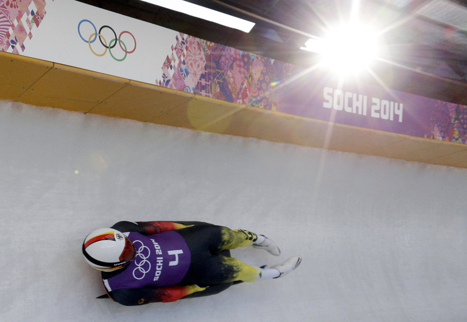 Photo - Felix Loch from Germany takes a turn during a training session for the men's singles luge at the 2014 Winter Olympics, Friday, Feb. 7, 2014, in Krasnaya Polyana, Russia. (AP Photo/Michael Sohn)