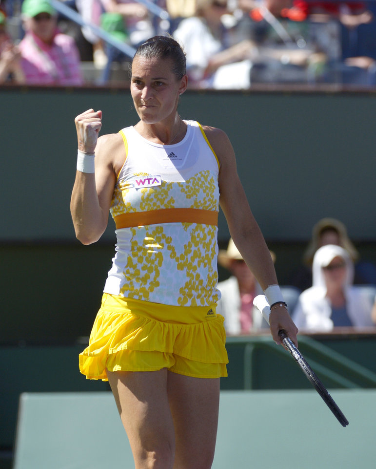 Photo - Flavia Pennetta, of Italy, celebrates after winning the first set of her finals match to Agnieszka Radwanska, of Poland, at the BNP Paribas Open tennis tournament, Sunday, March 16, 2014, in Indian Wells, Calif. (AP Photo/Mark J. Terrill)