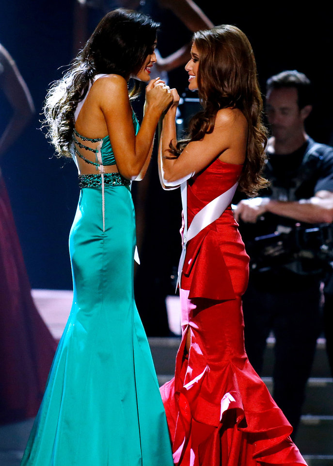 Photo - Miss North Dakota USA Audra Mari, left, and Miss Nevada USA Nia Sanchez await the final decision during the Miss USA 2014 pageant in Baton Rouge, La., Sunday, June 8, 2014. Sanchez would go on to win the Miss USA 2014 title. (AP Photo/Jonathan Bachman)