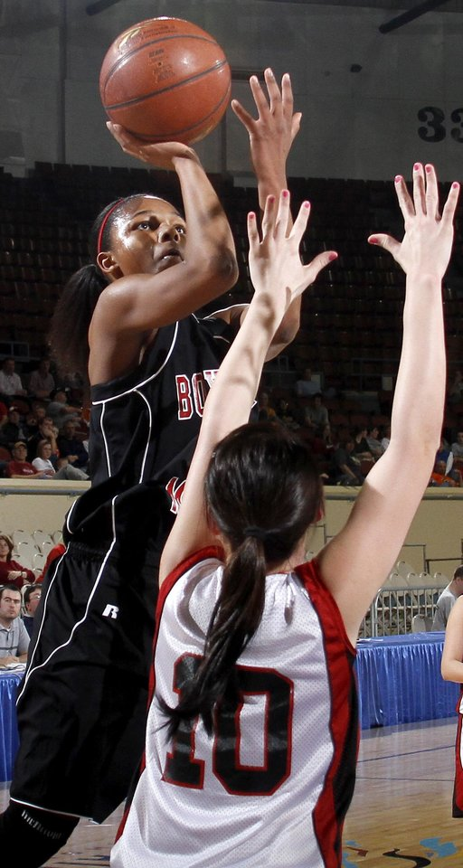 Photo - Boynton-Moton's Sherri Lang shoots the ball over Frontier's Tiffany Young during the Class B girls basketball state tournament at the State Fair Arena in Oklahoma City, Friday, March 5, 2010.  Photo by Bryan Terry, The Oklahoman