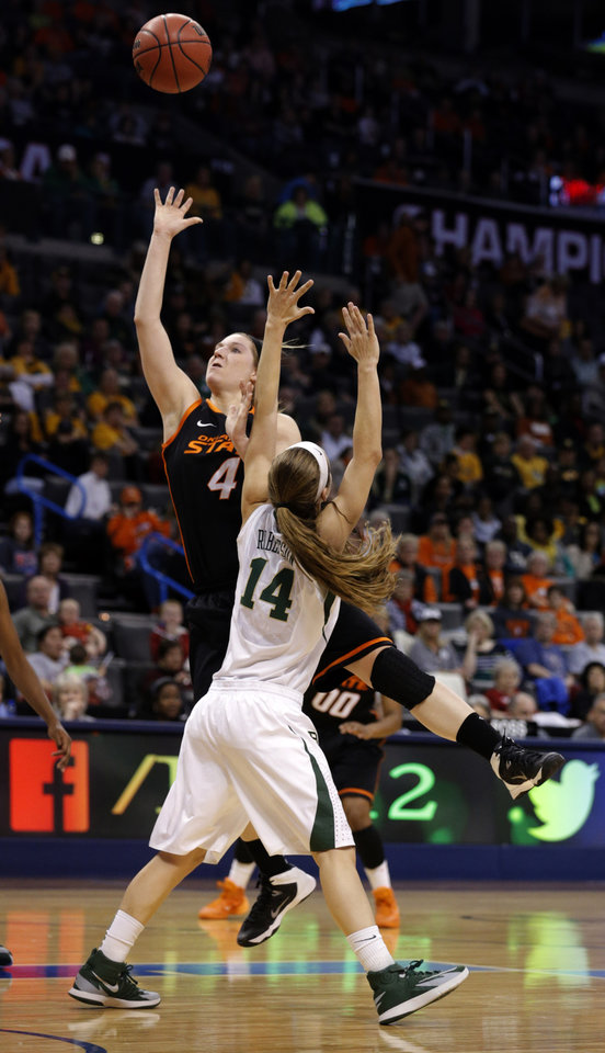 Photo - Oklahoma State's Liz Donohoe (4) shoots as Baylor's Makenzie Robertson (14) defends during the Women's Big 12 basketball tournament game between Baylor and Oklahoma State at Chesapeake Energy Arena  in Oklahoma City, Okla., Sunday, March 9, 2014. Photo by Sarah Phipps, The Oklahoman