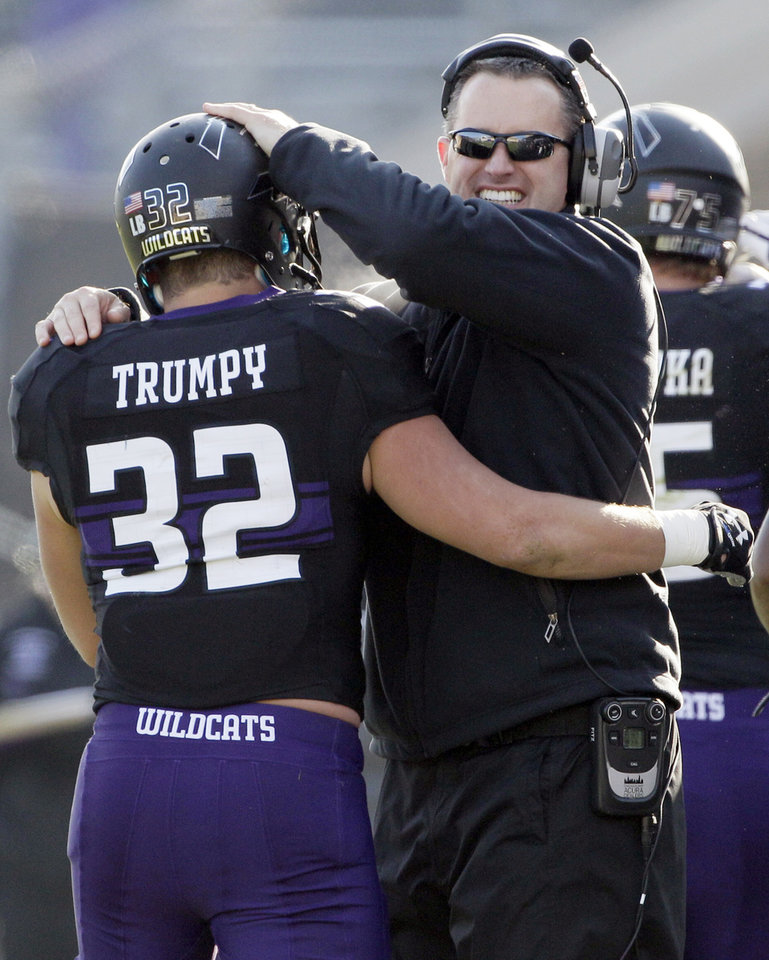 Photo -   Northwestern head coach Pat Fitzgerald, right, celebrates with running back Mike Trumpy after Trumpy scoring a touchdown during the second half of an NCAA college football game against Illinois in Evanston, Ill., Saturday, Nov. 24, 2012. Northwestern won 50-14. (AP Photo/Nam Y. Huh)