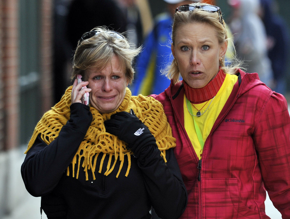 Women react as they walk from the area where there was an explosion after the Boston Marathon in Boston, Monday, April 15, 2013. (AP Photo/Josh Reynolds) ORG XMIT: BX101