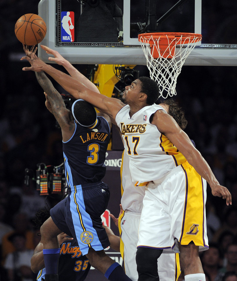 Photo -   Los Angeles Lakers center Andrew Bynum, right, blocks a shot by Denver Nuggets point guard Ty Lawson during the first half of an NBA first-round playoff basketball game, Sunday, April 29, 2012, in Los Angeles. (AP Photo/Mark J. Terrill)