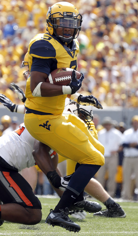 Photo - West Virginia's Charles Sims (3) rushes during the second half of a college football game between the Oklahoma State University and West Virginia University on Mountaineer Field at Milan Puskar Stadium in Morgantown, W. Va.,   Saturday, Sept. 28, 2013. Photo by Sarah Phipps, The Oklahoman