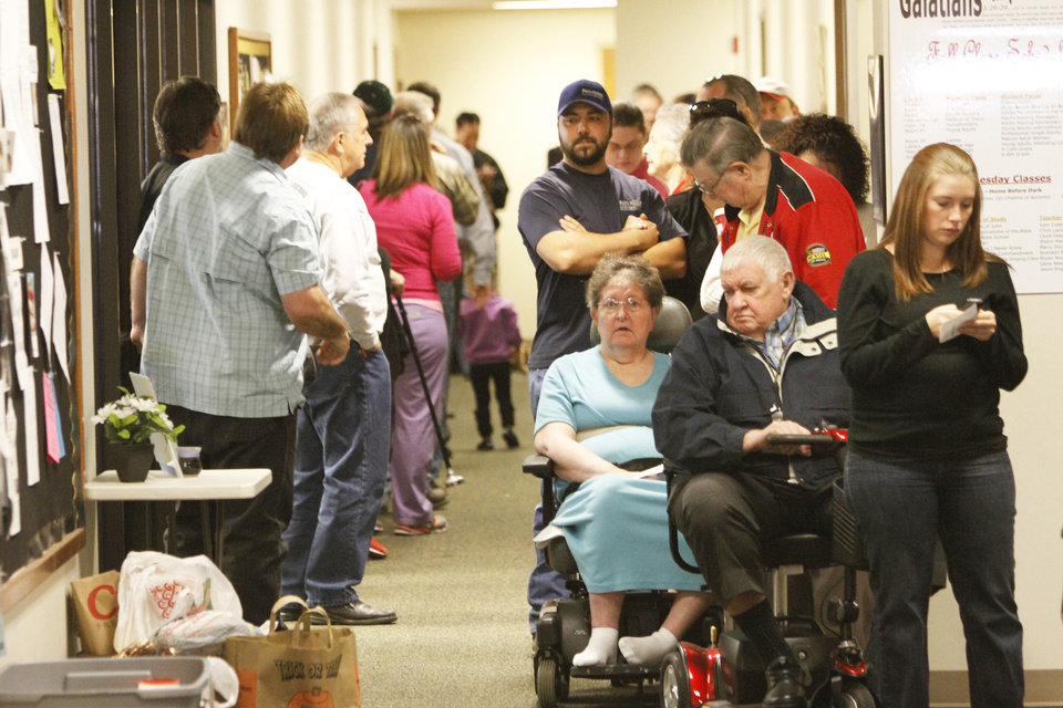 Voters had about a 90-minute wait in line to cast their vote Tuesday at Church of Christ in Yukon.  Photo By Steve Gooch, The Oklahoman