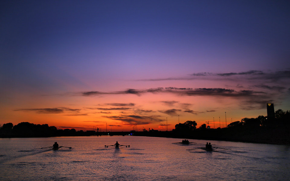 Photo -  Rowers practice as the sun sets on the Oklahoma river in Oklahoma City, Tuesday, Sept. 24, 2019. [Sarah Phipps/The Oklahoman]
