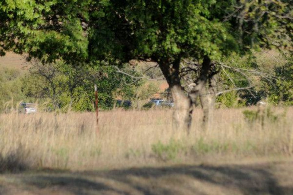 A line of vehicles can be seen near a field north of Fort Supply Lake where law enforcement officers were searching Wednesday for additional remains after bones were found Tuesday by teenage hunters. (Photo by Rowynn Ricks, Woodward News) ORG XMIT: KOD Rowynn Ricks - Rowynn Ricks, Woodward News
