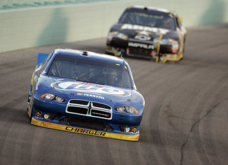 Photo -   Brad Keselowski competes during the NASCAR Sprint Cup Series auto race at Homestead-Miami Speedway, Sunday, Nov. 18, 2012, in Homestead, Fla. (AP Photo/The Miami Herald, Andrew Uloza) MAGS OUT