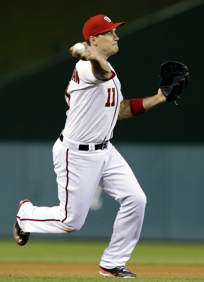 Photo - Washington Nationals third baseman Ryan Zimmerman (11) throws out Detroit Tigers' Omar Infante during the fourth inning of a baseball game at Nationals Park, Wednesday, May 8, 2013, in Washington. (AP Photo/Alex Brandon)