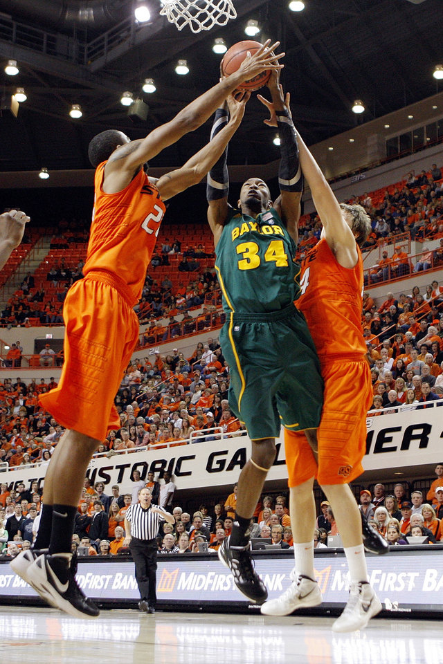 Photo - From left, OSU's Michael Cobbins (20), Baylor's Cory Jefferson (34) and OSU's Marek Soucek (14) try for a rebound in the second half of a men's college basketball game between the Oklahoma State University Cowboys and the Baylor University Bears at Gallagher-Iba Arena in Stillwater, Okla., Saturday, Feb. 4, 2012. Baylor beat OSU, 64-60. Photo by Nate Billings, The Oklahoman
