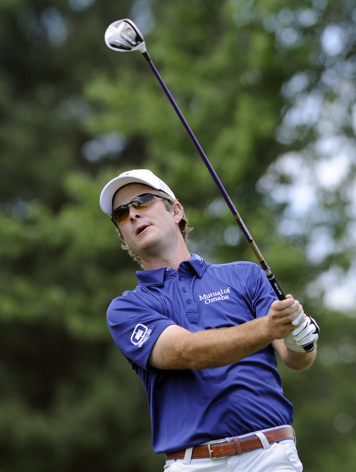 Photo - Kevin Streelman watches his drive on the second hole during the final round of theTravelers Championship golf tournament in Cromwell, Conn., Sunday, June 22, 2014. Streelman finished his round with seven straight birdies to win the tournament at 15-under par. (AP Photo/Fred Beckham)