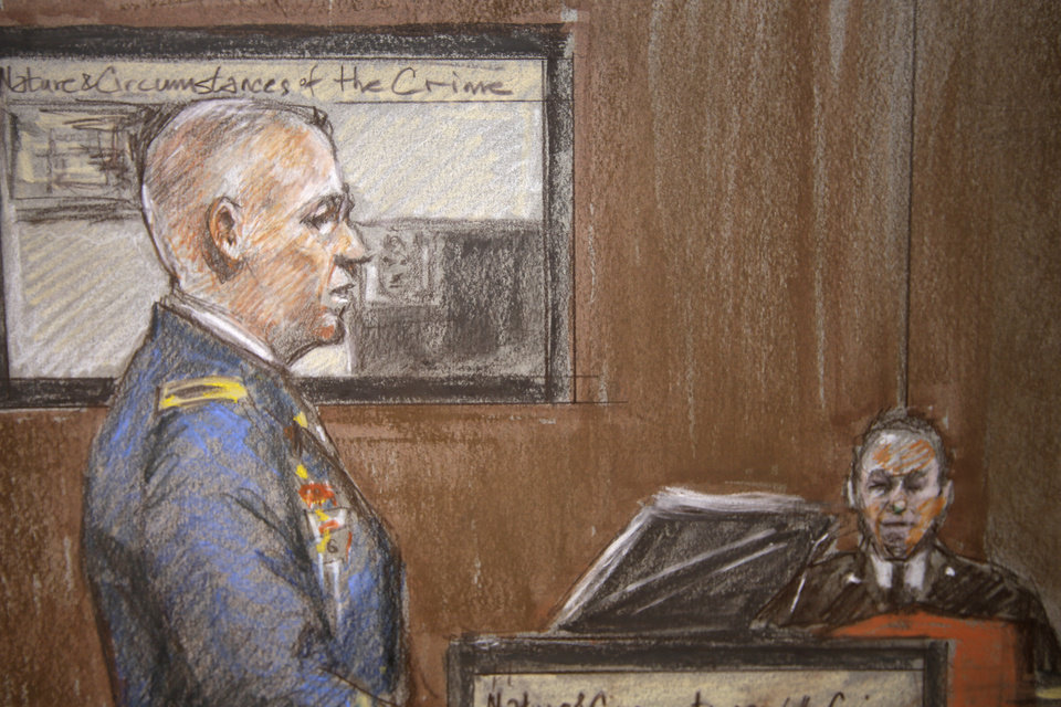 Photo - In this courtroom sketch, U.S. Army Col. Steve Henricks, a member of the prosecution, delivers closing arguments as the courtroom bailiff, right rear, watches during court proceedings in the court martial of U.S. Army Maj. Nidal Malik Hasan, Thursday Aug. 22, 2013, in Fort Hood, Texas. (AP Photo/Brigitte Woosley)