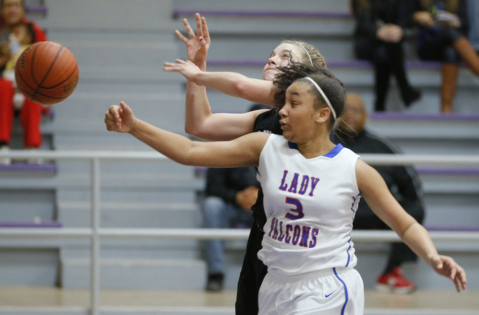 Photo - Deer Creek's Abbey Renner, back, is fouled by Millwood's Awreona Ransom during Friday's game in the Bethany Classic.  Photo by Bryan Terry, The Oklahoman