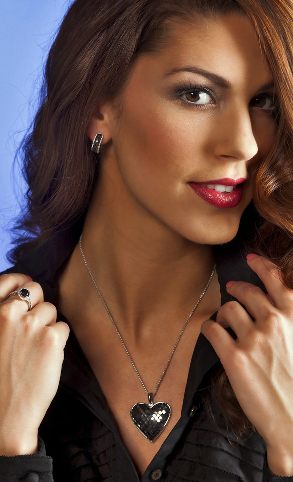 Photo - Black diamond heart pendant set with princess-cut diamonds, total weight of 15.43 carats. Ring is a black 2-carat round-cut diamond with a halo of white diamonds. Model is Alexandra. Makeup by Shellie Pickens for The Makeup Bar.  Jewelry sold at Samuel Gordon Jewelers. Photo by Chris Landsberger, The Oklahoman.  CHRIS LANDSBERGER