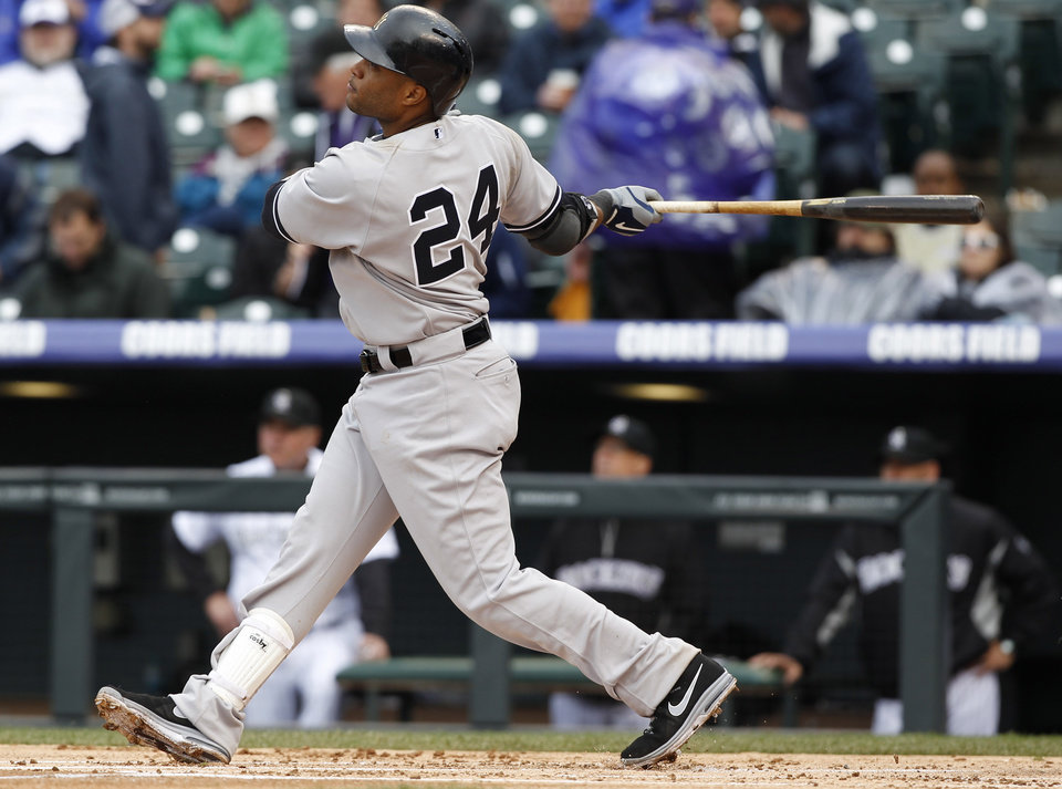 Photo - New York Yankees' Robinson Cano follows the flight of his solo home run off Colorado Rockies relief pitcher Adam Ottavino in the fifth inning of a baseball game in Denver on Thursday, May 9, 2013. (AP Photo/David Zalubowski)