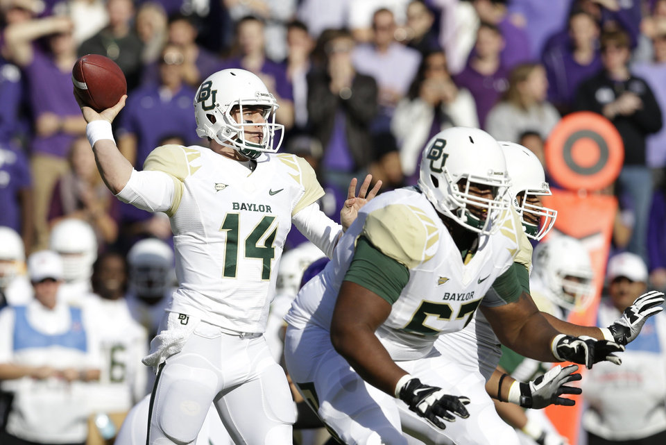 Baylor quarterback Bryce Petty (14) passes with protection from offensive linesman Desmine Hilliard (67) and other teammates during the first half of an NCAA college football game against TCU, Saturday, Nov. 30, 2013, in Fort Worth, Texas. (AP Photo/LM Otero)