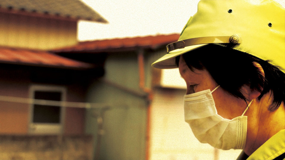 "In this image made from a scene from the film �Fukushima: Memories of the Lost Landscape"" released by Yojyu Matsubayashi, Kyoko Tanaka, a city council member of Minami Soma, patrols in the deserted town after evacuation of the residents, on April 3, 2011. Japanese film director Matsubayashi took a more standard documentary approach for his �Fukushima: Memories of the Lost Landscape,� interviewing people who were displaced in the Fukushima town of Minami Soma. He followed them into temporary shelters in cluttered gymnasiums and accompanied their harried visits to abandoned homes with the gentle patience of a video-journalist. The March 2011 catastrophe in Japan has set off a flurry of independent films telling the stories of regular people who became overnight victims, stories the creators feel are being ignored by mainstream media and often silenced by the authorities. (AP Photo/Yojyu Matsubayashi) MANDATORY CREDIT, EDITORIAL USE ONLY"