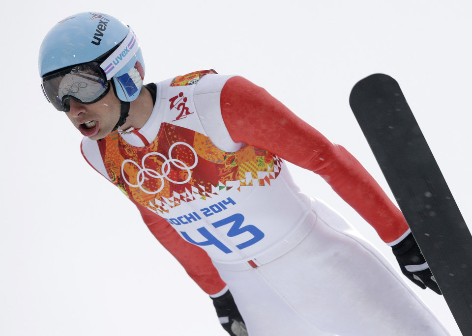 Photo - France's Jason Lamy Chappuis makes his trial jump during the Nordic combined individual Gundersen large hill competition at the 2014 Winter Olympics, Tuesday, Feb. 18, 2014, in Krasnaya Polyana, Russia. (AP Photo/Matthias Schrader)