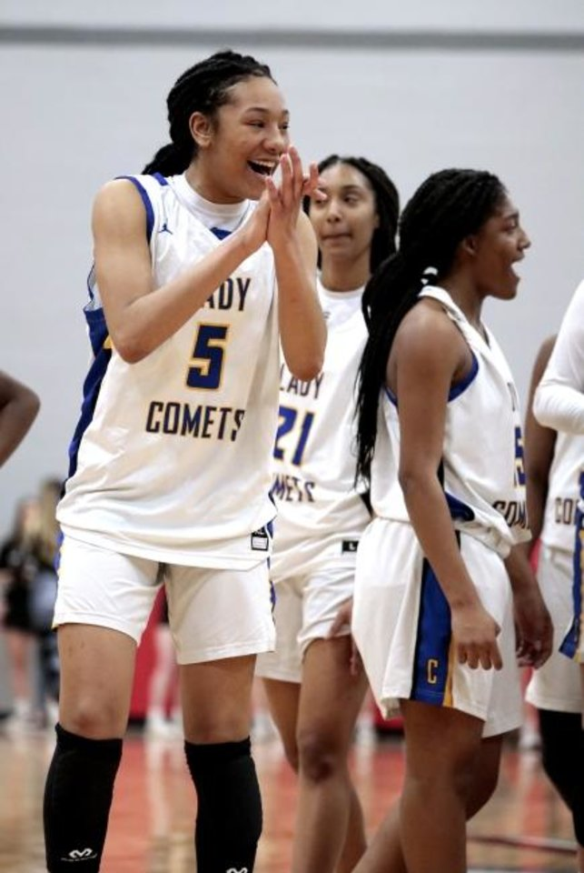 Photo -  Lady Comet Darianna Littlepage-Buggs celebrates as Classen SAS defeats Newcastle 53-34 in the Area 3 Class A girls basketball tournament on March 6, 2020 in Washington, Okla.  [Steve Sisney/For The Oklahoman]