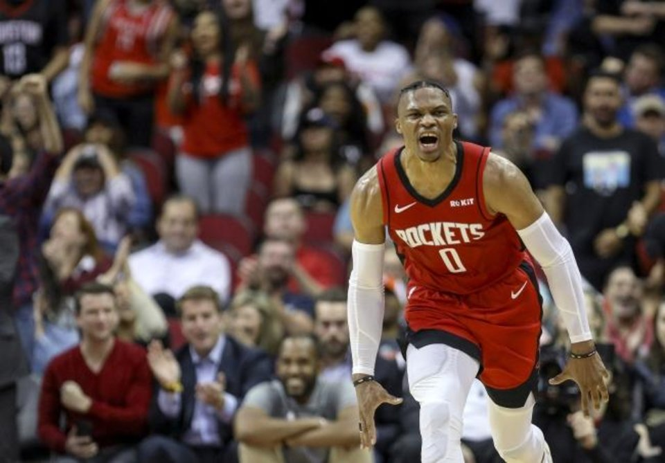 Photo -  Rockets guard Russell Westbrook celebrates after a dunk in the fourth quarter Monday. [Jon Shapley/Houston Chronicle]