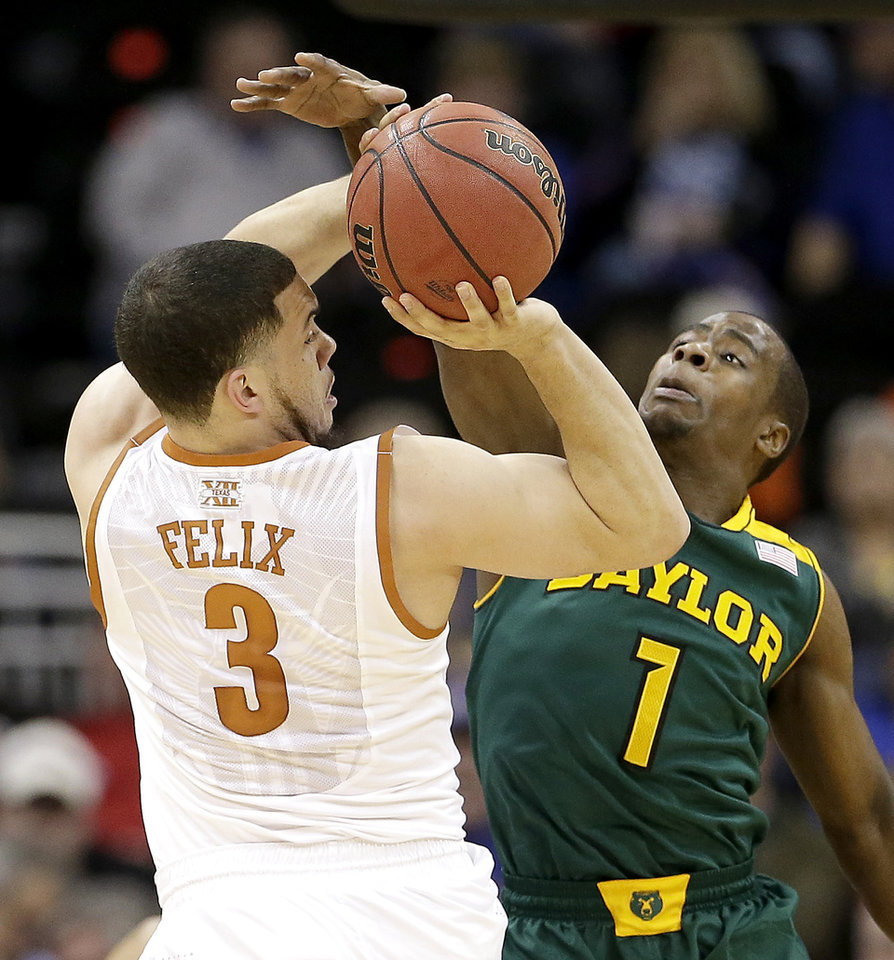 Photo - Baylor's Kenny Chery (1) tries to block a shot by Texas' Javan Felix (3) during the first half of an NCAA college basketball game in the semifinals of the Big 12 Conference tournament on Friday, March 14, 2014, in Kansas City, Mo. (AP Photo/Charlie Riedel)