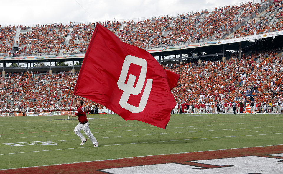 The Sooners celebrate a touchdown in the second half during the Red River Rivalry college football game between the University of Oklahoma Sooners (OU) and the University of Texas Longhorns (UT) at the Cotton Bowl in Dallas, Saturday, Oct. 8, 2011. Photo by Chris Landsberger, The Oklahoman