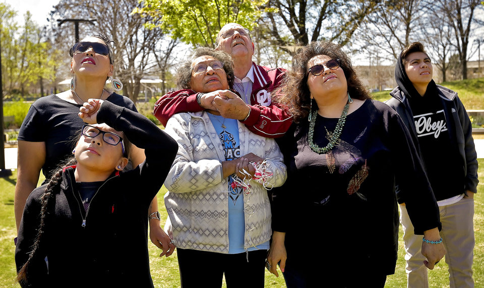 Photo - The Wahnee family members watch the balloons they released float through the sky as they honor Bradley Wahnee, who was killed in 2009 during a drive by shooting, to mark his birthday at the Myriad Botanical Gardens in Oklahoma City, Okla. on Monday, March 21, 2016. The family releases balloons every year on Bradley's birthday and the date he was killed.  Photo by Chris Landsberger, The Oklahoman