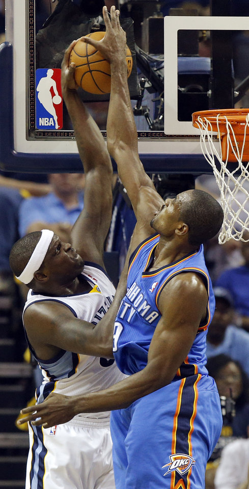Photo - Oklahoma City's Serge Ibaka (9) blocks the shot of Memphis' Zach Randolph (50) during Game 4 in the first round of the NBA playoffs between the Oklahoma City Thunder and the Memphis Grizzlies at FedExForum in Memphis, Tenn., Saturday, April 26, 2014. Photo by Bryan Terry, The Oklahoman