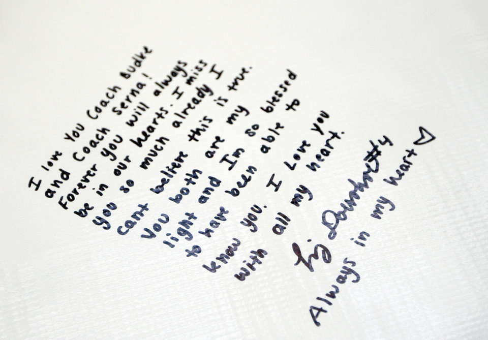 Oklahoma State basketball player Liz Donohoe's words are written on a banner for  OSU women's head coach Kurt Budke and assistant coach Miranda Serna at Gallagher- Iba Arena in Stillwater, Okla.,  Friday, Nov. 18, 2011.  Photo by Sarah Phipps, The Oklahoman