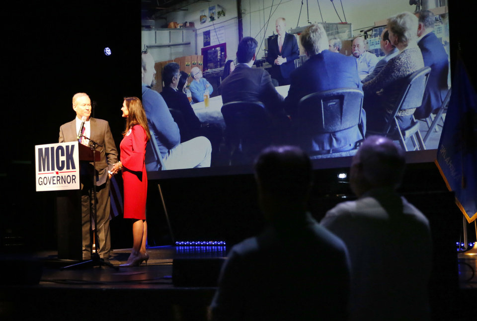 Photo - Mick Cornett gives a concession speech with his wife Terri during a watch party at the Tower Theatre in Oklahoma City , Tuesday, Aug. 28, 2018. Photo by Sarah Phipps, The Oklahoman
