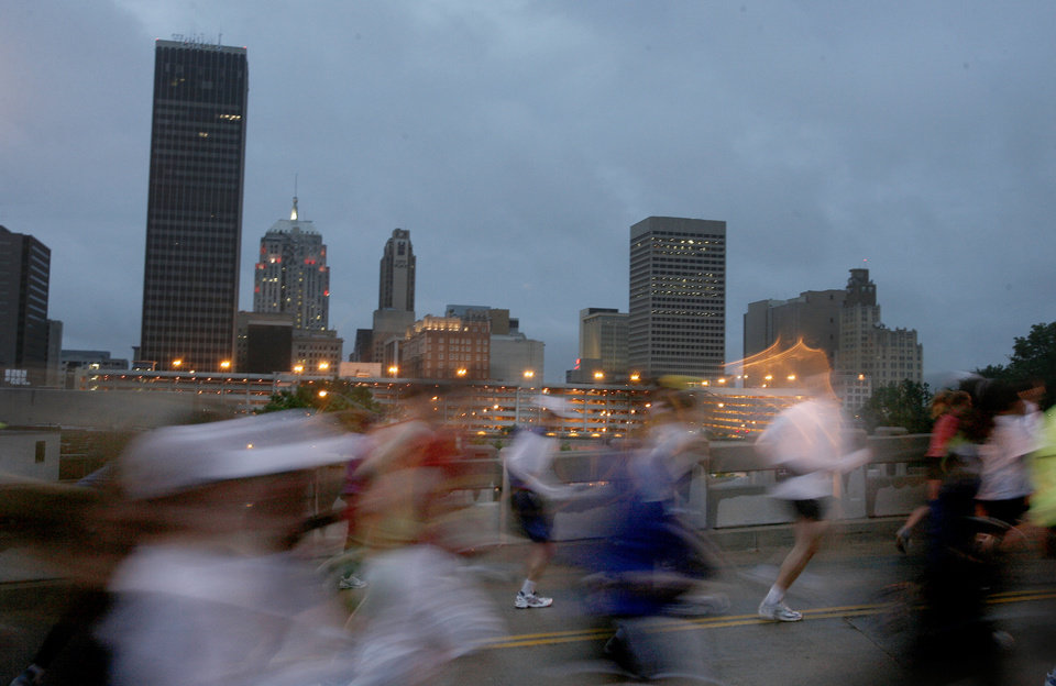 Marathon runners run up the Walnut Street bridge during the 8th annual Oklahoma City Memorial Marathon on Sunday, April 27, 2008, in Oklahoma City, Okla.