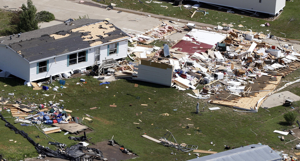 Photo -   RE-TRANS FOR IMPROVED TONING - An aerial view of the destruction of the Oaklawn neighborhood in Wichita, Kan. on Sunday, April 15, 2012. The damage was caused by one of several tornadoes that his the state on Saturday, April 14, 2012. (AP Photo/Jeff Tuttle)