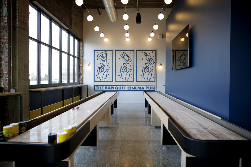 Photo -  A shuffle board room is among the amenities at Banquet Cinema Pub. [Photo by Bryan Terry, The Oklahoman]