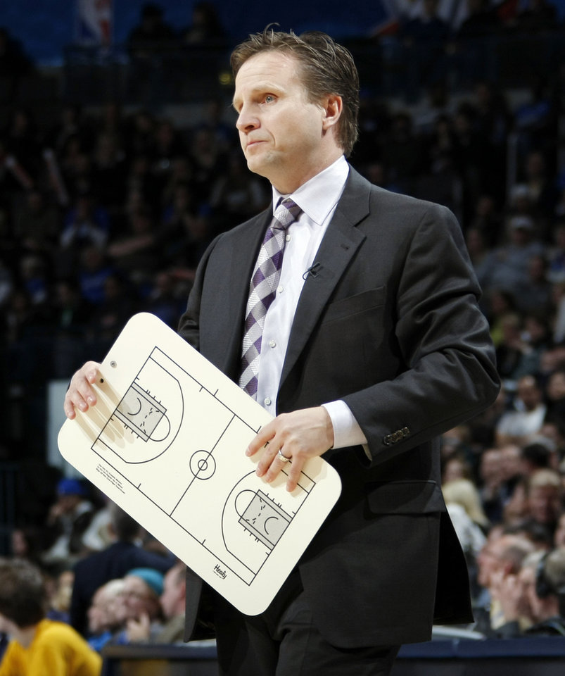 Photo - Oklahoma City head coach Scott Brooks stands during a timeout in the NBA basketball game between the Orlando Magic and Oklahoma City Thunder in Oklahoma City, Thursday, January 13, 2011. Photo by Nate Billings, The Oklahoman