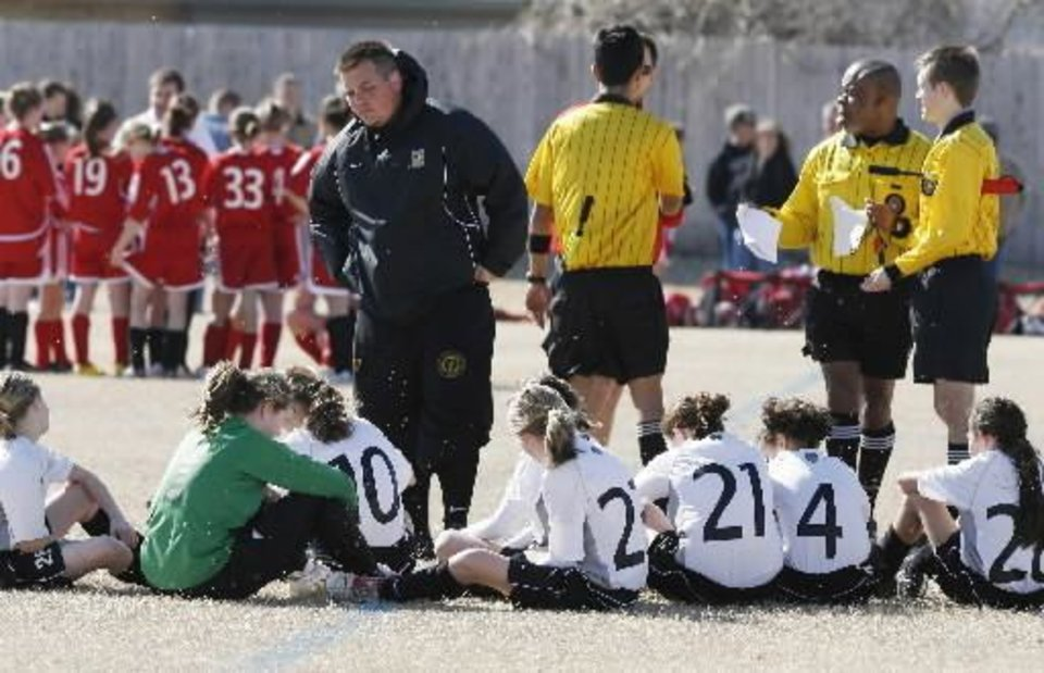 Photo - Teams prepare for play during the first day of the  Edmond  Soccer  Club's new season in  Edmond, OK, Saturday, March 1, 2008. BY PAUL HELLSTERN