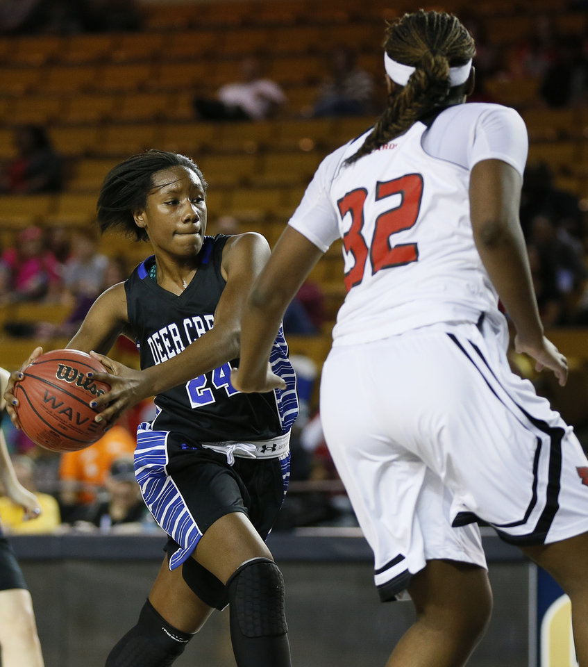 Photo - Deer Creek's Dakota Vann (24) takes the ball to the basket against East Central's Sharayla Brown (32) during the Class 5A girls championship game in the state high school basketball tournament between Deer Creek and Tulsa East Central at the Mabee Center in Tulsa, Okla., Saturday, March 15, 2014. Photo by Nate Billings, The Oklahoman