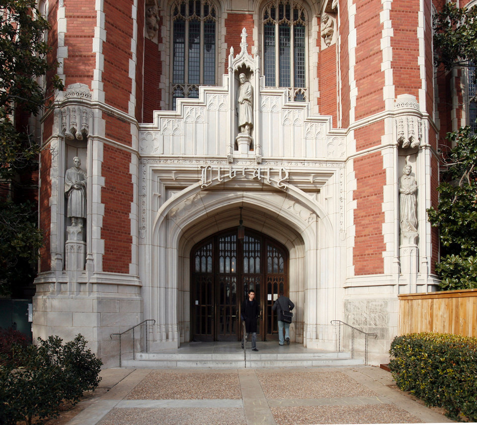 Above: A statue of Jesse Lee Rader, left, watches over the entrance to the Bizzell Library at the University of Oklahoma in Norman. Photo by Steve Sisney, The Oklahoman