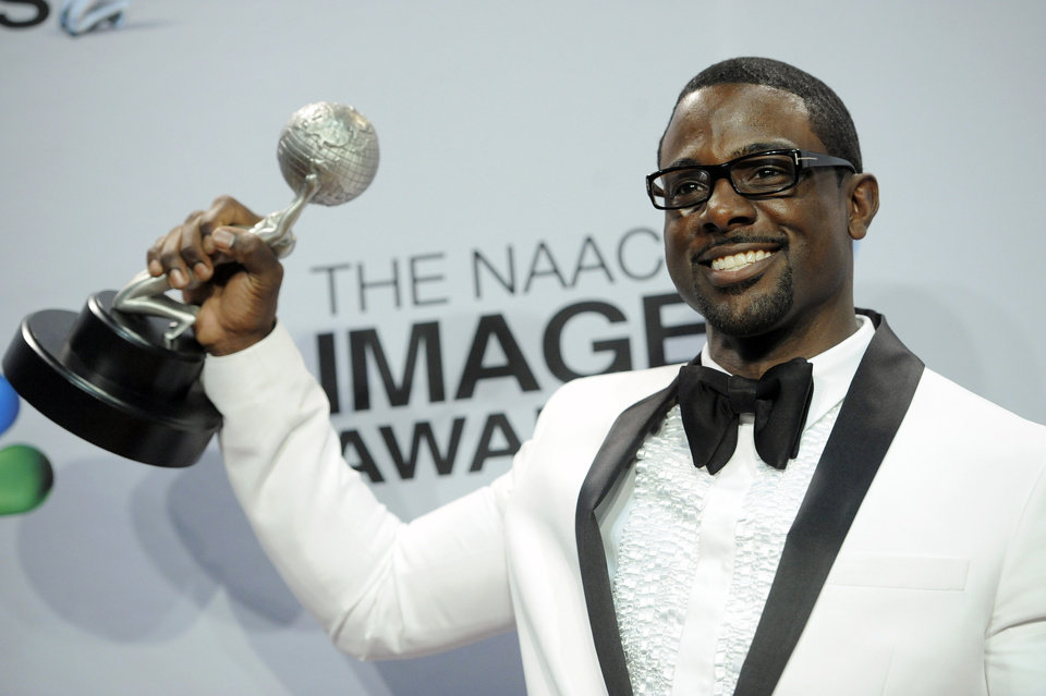 Photo - Lance Gross poses backstage with the award for outstanding supporting actor in a comedy series for