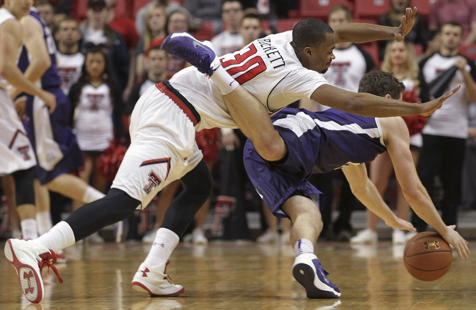 Photo - Texas Tech's Jaye Crockett and TCU's Hudson Price scramble for the ball during an NCAA college basketball game in Lubbock, Texas, Saturday, Feb, 1, 2014. (AP Photo/Lubbock Avalanche-Journal, Tori Eichberger)