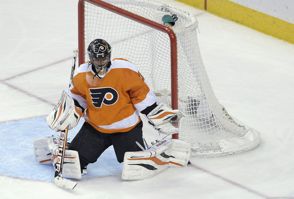 Philadelphia Flyers\' Ilya Bryzgalov (30), of Russia, makes a glove save in the third period of an NHL hockey game against the Boston Bruins, Saturday, March 30, 2013, in Philadelphia. The Flyers won 3-1. (AP Photo/Michael Perez)