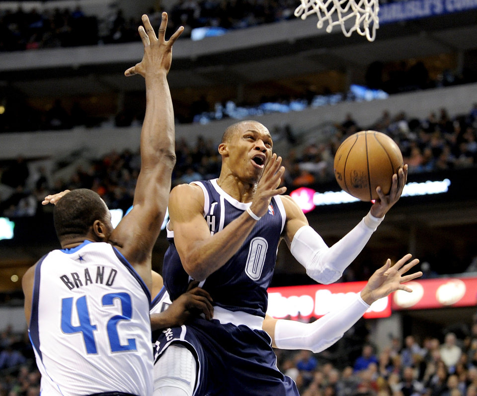 Oklahoma City Thunder guard Russell Westbrook (0) drives around Dallas Mavericks forward Elton Brand (42) during the first half of an NBA basketball game, Friday, Jan. 18, 2013, in Dallas. (AP Photo/Matt Strasen) ORG XMIT: TXMS202