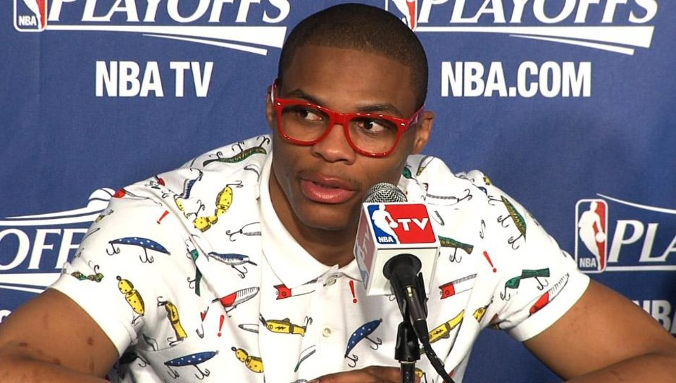 Photo - Russell Westbrook in post game press conference wearing his red glasses and fishing lure shirt. Frame grab from NewsOK.tv